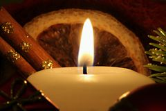Illuminated holiday candle Stock Photography
