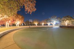 Illuminated holiday lightings at public park with basketball court in Texas, America royalty free stock images