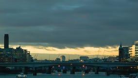 Illuminated horizon at sunset on the Thames, London stock video