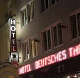 Illuminated hotel sign and bright red and white neon on exterior royalty free stock images