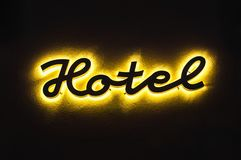 Illuminated hotel sign on the building Stock Photos