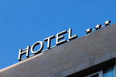 Illuminated hotel sign in the morning Royalty Free Stock Photo