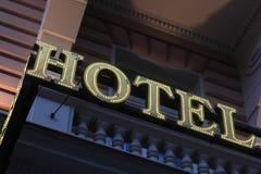Illuminated hotel sign Stock Images