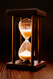 Illuminated hourglass in a wooden frame Stock Images