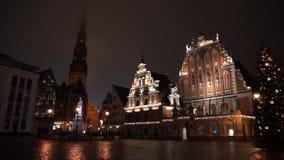 Illuminated house of the Blackheads at night stock footage