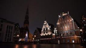 Illuminated house of the Blackheads at night stock video
