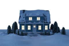 Illuminated house covered in snow Stock Photography