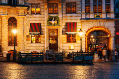 Illuminated houses at the Grand Place square at night in Brussels, Belgium Stock Image