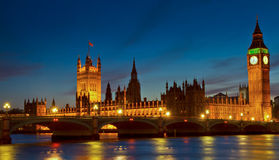 Illuminated Houses of Parliament at twilight Stock Photo