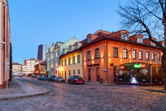 Illuminated houses on the Theatre Square in the early morning. Klaipeda, Lithuania. Stock Photo