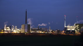 Illuminated industrial area and power plant at night stock video