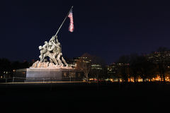 Illuminated Iwo Jima US Marine War Memorial DC. The figures of the Marines in the Iwo Jima Memorial, Washington, DC, erect a 60-foot bronze flagpole from which a Stock Images