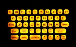 Illuminated Keyboard. Yellowish illuminated Keyboard royalty free stock image