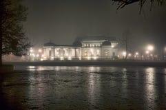Illuminated lakeside mansion Royalty Free Stock Photos