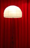 Illuminated Lamp. An illuminated lamp with a red curtain behind Royalty Free Stock Image
