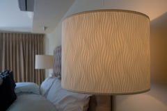 Illuminated lamp in bedroom Stock Image
