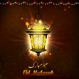 Illuminated lamp on Eid Mubarak background. Illustration of illuminated lamp on Eid Mubarak background Stock Photos