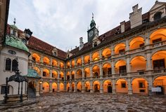 Illuminated Landhaus courtyard with a bronze fountain at sunset. Graz, Austria. The arcaded inner courtyard of a Landhaus in Graz. Austria. It ranks among the royalty free stock images