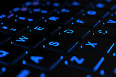 Illuminated laptop keyboard Stock Images