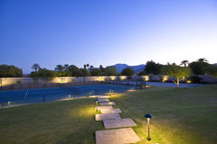 Illuminated Lawn And Tennis Court Stock Image