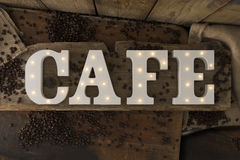 Illuminated Letters Spelling CAFE on Wooden Surface Stock Photography