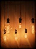 Illuminated light bulbs on a vintage background Stock Images