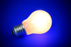 Illuminated lightbulb Stock Photos