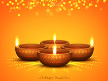 Illuminated Lit Lamp for Diwali Celebration. Glowing Illuminated Oil Lit Lamps on beautiful Rangoli, Elegant Diwali Background, Creative Greeting Card, Vector Royalty Free Stock Images