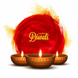Illuminated Lit Lamps for Diwali Celebration. Glossy Illuminated Oil Lit Lamps on abstract paint stroke, Creative Diwali Festive Background, Beautiful Greeting Stock Image