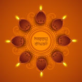 Illuminated lit lamps for Happy Diwali celebration. Traditional illuminated oil lit lamps on beautiful floral rangoli for Indian Festival of Lights, Happy