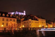 Illuminated Ljubljanas castle raising above old city centre Stock Image