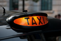 Illuminated London Taxi Sign. Ready for hire Royalty Free Stock Images