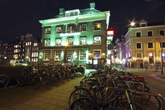 Illuminated medieval buildings in Amsterdam the Netherlands at n Royalty Free Stock Photo