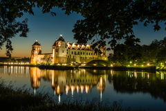 Illuminated medieval castle in the Belarusian town of Mir Stock Photography