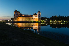 Illuminated medieval castle in the Belorussian town of Mir at night Stock Photo