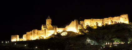 Illuminated Medieval castle of Narikala in Tbilisi Stock Images
