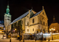 Illuminated Medieval Church in the Center of Megeve stock photography