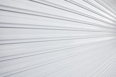 Illuminated  metallic roller shutter door Royalty Free Stock Photography