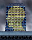 Illuminated Mind. With a commercial building as windows with the light turned on forming a profile of a human head as a symbol of life and health also education Royalty Free Stock Images
