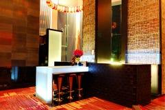 The Illuminated modern bar interior Stock Images