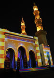 Illuminated mosque. A Ramadan moon and the mosque at night Royalty Free Stock Photography
