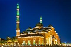 Illuminated mosque in night Stock Images