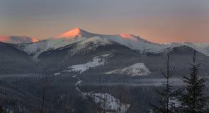 Illuminated mountains - winter scene Stock Photography