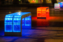 Illuminated multicolored benches stock photography
