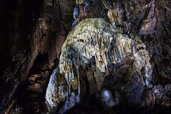 Illuminated multicolored stalactites in cave HAN-SUR-LESSE stock photography