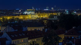 Illuminated National Theatre in Prague at night with reflection in Vltava River timelapse, Czech Republic. Top view from Lesser Town Tower stock video footage