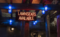 An illuminated neon sign stating `lawnseats available` Stock Images