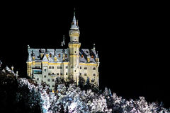 Illuminated Neuschwanstein castle in a winter night Royalty Free Stock Photo