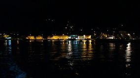 Illuminated night harbor stock footage