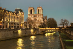 Illuminated Notre Dame de Paris Cathedral and Seine River Royalty Free Stock Image